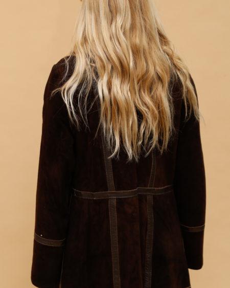 Veste en daim et fourrure avec empiècements en cuir